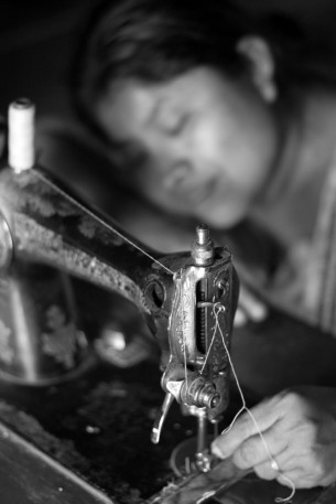 Valeria at her treadle machine, Belize