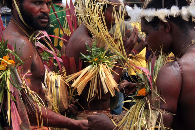 Head hunters in full regalia, New Guinea