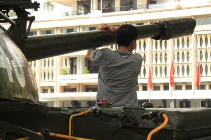 Hanging from the tank gun, Saigon