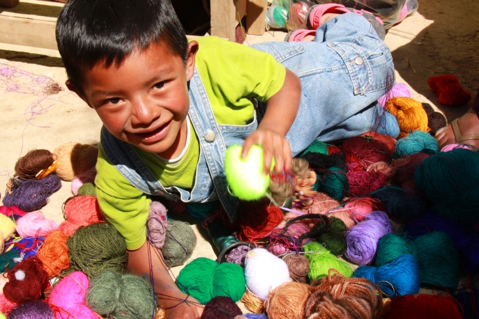 Gabriel playing with his sisters' wool, Mexico