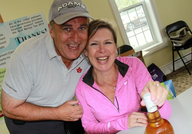 Neil Ellis & Kristin Crowe sharing a bottle - of maple syrup