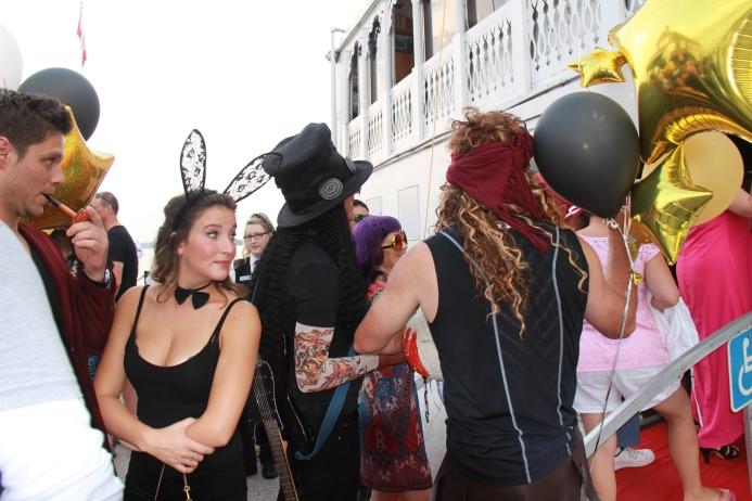 Playboy Bunny & Slash wait to board the Island Queen