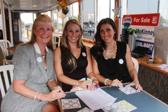Jennifer Albright, Sarah Dean, & Nicole Haire: The ReMax Team greets the guests