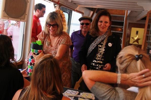 Joanne Wheeler, Ken Wheeler, & Cathy Portt boarding the Island Queen
