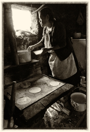 Magdalena at her low-smoke stove, Mexico