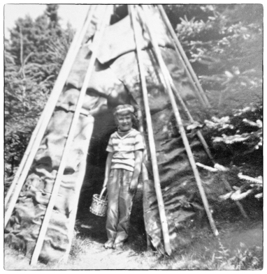 Lola in Miqmaq tipi with woven Miqmaq basket - Nova Scotia 1961