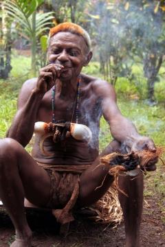 Headhunter enjoying a smoke, Papua New Guinea