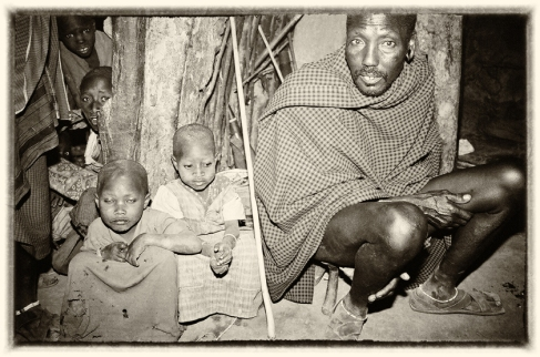 Kopune with some of his children inside his home, East Africa
