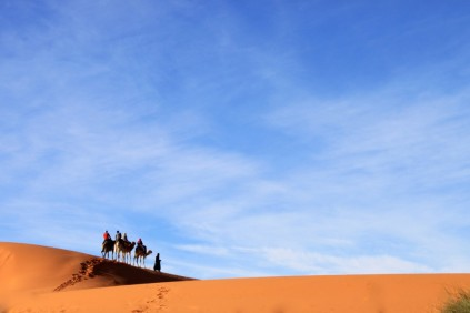 Camel caravan under the sheltering sky