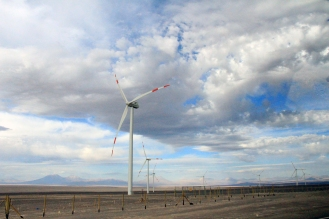 Windmills planted on the barren ground - east of Calama, west of the Andes