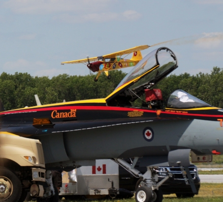 Kent Pietsch in Jelly Belly, an Interstate Cadet, landing behind Canada's CF-18 Hornet