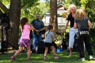 Cathy Finkle dances with children to the music of Post Office Wall Rock