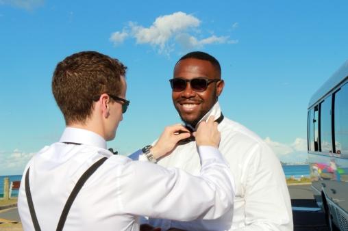 Groom Jimmy straightens Osie's tie
