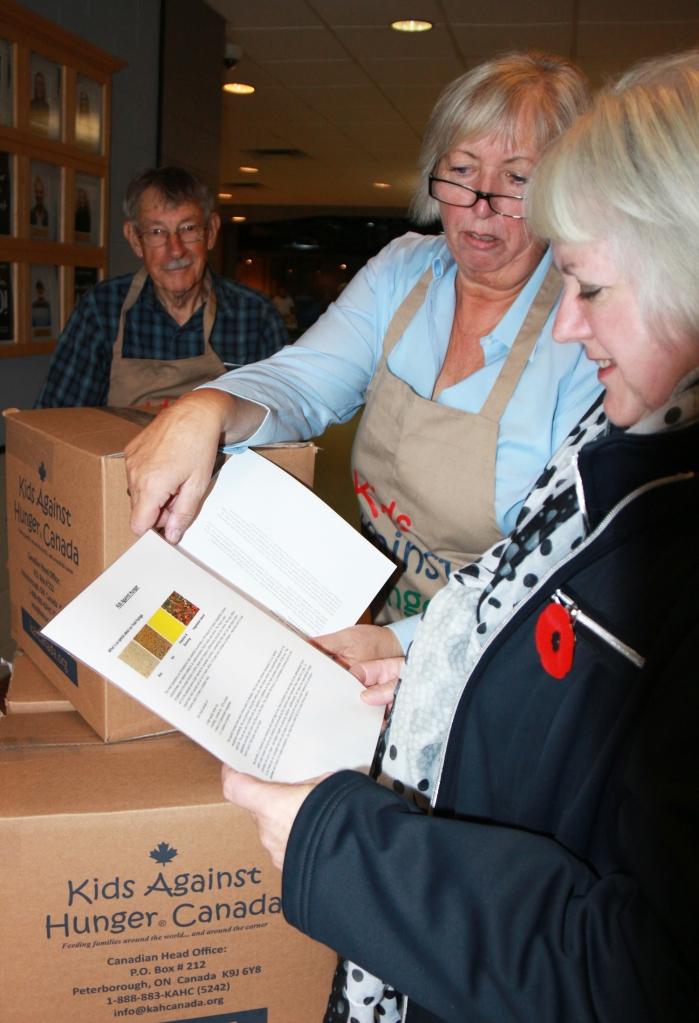 Rotarians Don Holmes &0amp; Birgit Wartenberg with Gleaners' ED Susanne Quinlan