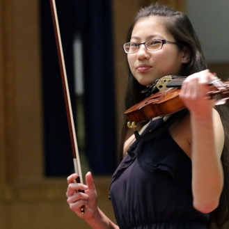 Jeanette Huang prepares the violin
