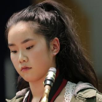 Tina Li preparing to play Premiere Etude de Concours (Tenor Sax) by Pierre Pete