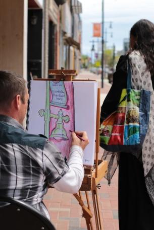 Artist appreciating downtown