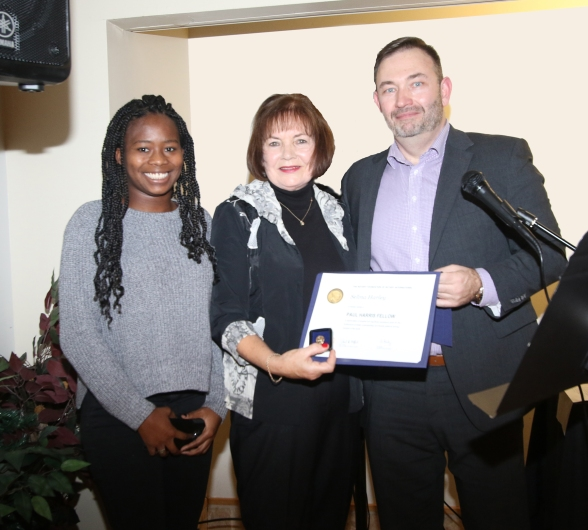 Past President Shannon Neely presents certificate to Selina Harley (shown with her adopted daughter)