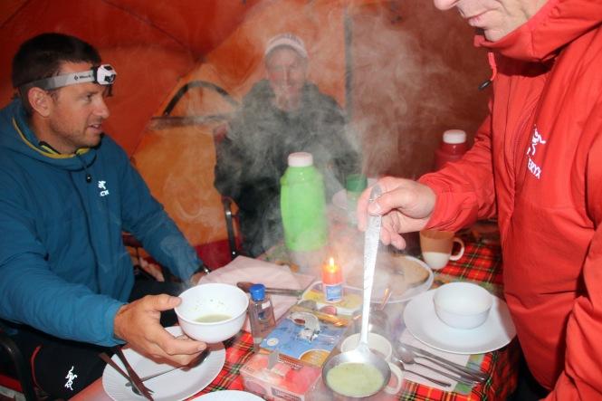 Jeff serving soup to John