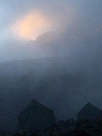 Sun, mist, mountain