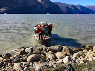 "Captain Billy of Qikiqtarjuaq ""docks"" the boat at Pangnirtung North Fjord"